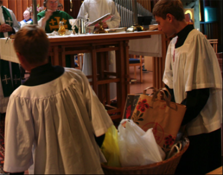 Acolytes bring forward Sunday donations for the Berkeley Food Pantry