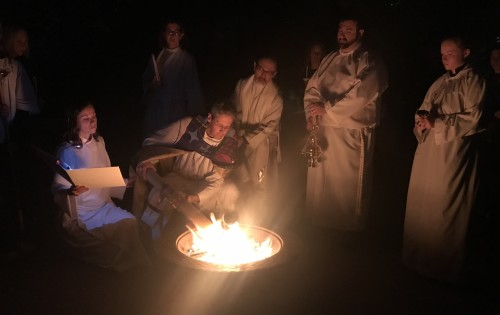 Lighting the paschal candle from the new fire at the Easter Vigil.