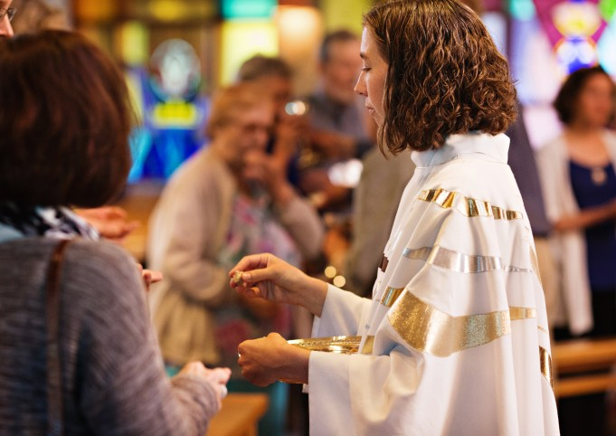 Liz giving communion